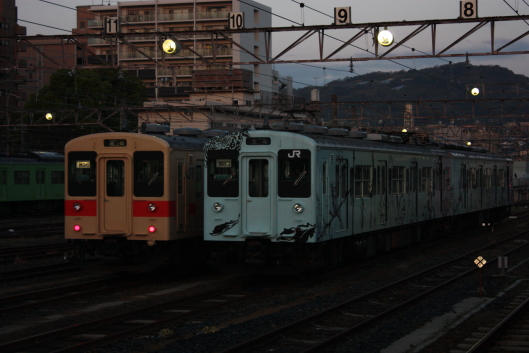There were many trains that were waiting for the start at the early morning station.
